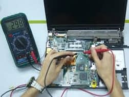 technician doing computer repair
